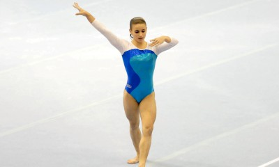 Jade Barbosa, Brazilian artistic gymnast, performing a turn during a floor routine, 2007