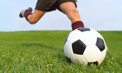 Soccer Player Kicking --- Image by © Royalty-Free/Corbis